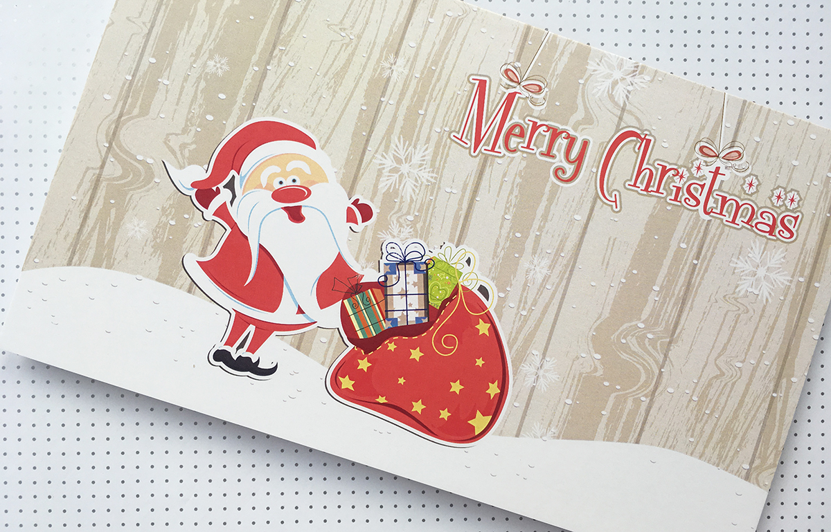 Merry Christmas greeting card with Santa and gifts