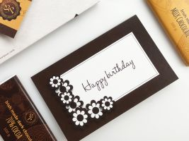 Happy birthday greeting card with chocolate flowers